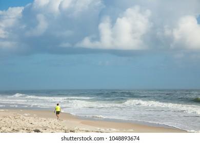 A lone beach walker on the white sand beach on Cumberland Island, Georgia.