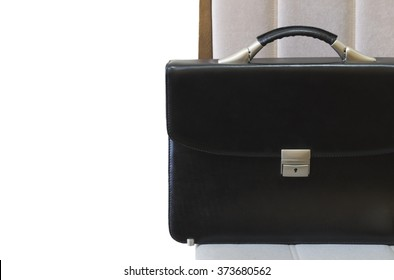 lone black briefcase on a wooden table