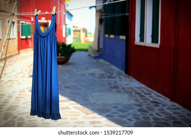 Lone Blue dress hanging out to dry