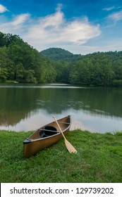 Lone boat sitting on the shore of a Western North Carolina lake ready for recreation near the Blue Ridge Parkway in Asheville, NC.