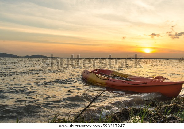 Lone boat sitting on the shore