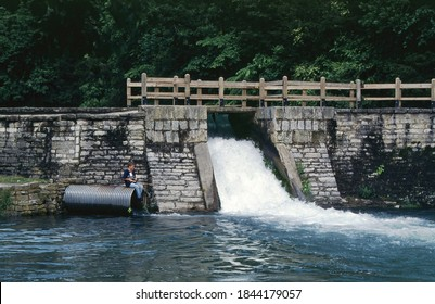 A lone boy fishes by the spillway at Roaring River State Park near Cassville, Missouri on July 2, 2005. Roaring River is one of Missouri's cold water state parks that is stocked with rainbow trout.