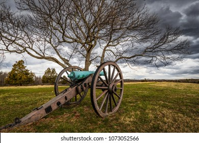 A lone cannon from the US Civil War quietly sits on a hill overlooking a Virginia meadow.