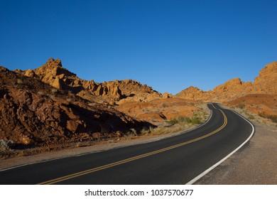 Lone desert road in a barren landscape