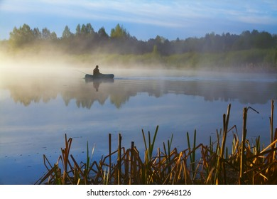 Lone fisherman on the lake early in the morning