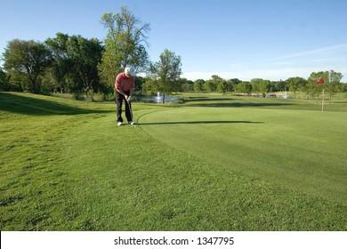 Lone golfer taking aim