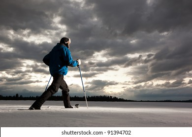 Lone Hiker in Snowshoes