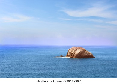 Lone Island in Vast Pacific Ocean at Oaxaca coast, Mexico