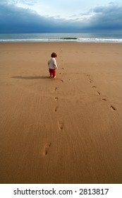 lone kid on the beach