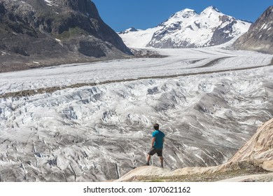 Lone male climber looking out, Aletsch Glacier, Canton Wallis, Switzerland
