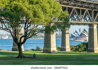 A lone man sits at a picnic table at Bradfield Park in Sydney, Australia.