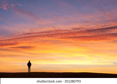 Lone Man's Sihlouette against Glorious Sunset Glow