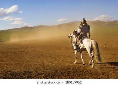 Lone Mongolian Man on a Horse in The Dessert
