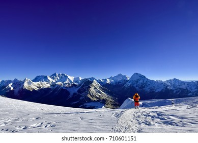 A lone Mountaineer walking down from Mera Peak in front of Mt. Everest, Lhotse ,Makalu, Ama Dablam etc.