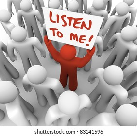 A lone person seeks to inform the crowd of people around him of some important information, raising a sign or placard that reads Listen to Me in hope of grabbing attention and getting an audience