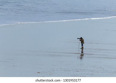 Lone Photographer on deserted beach in the stunning and beautiful North Cornwall