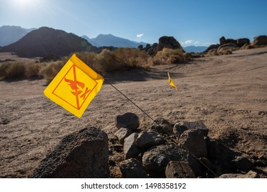Lone Pine, California / USA - August 20 2019: yellow warning flags not to burn camp fires placed in wilderness fire pits to help prevent wildfires in California