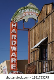 Lone Pine, California USA - September 11, 2018: Neon sign for hardware store advertising sporting goods with a large neon trout. The Eastern Sierra town is a center for fishing and outdoor recreation.