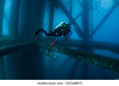 Lone re-breather diver on oil rig