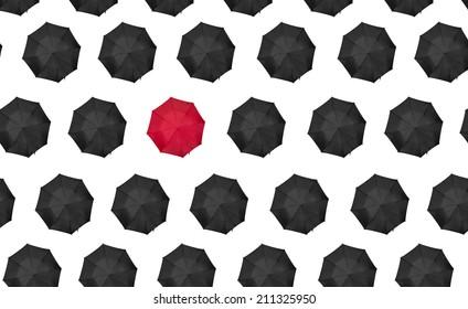 lone red umbrella with black umbrellas