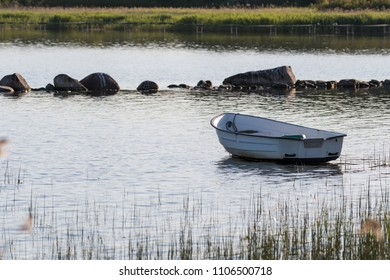 Lone rowing boat by the coast of the Baltic Sea in Sweden