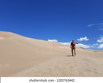 Lone sandboarder - The Great Sand Dunes National Park - Southern CO