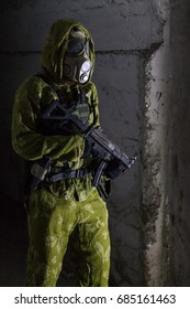 Lone soldier in gas mask standing guard at dark fallout shelter - full view