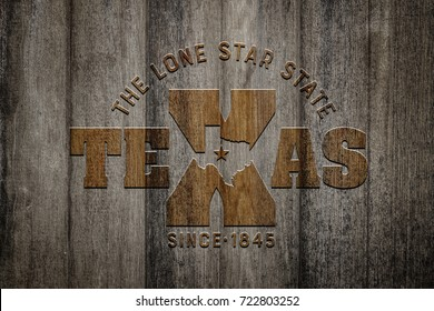 The Lone Star State TEXAS on old wood background