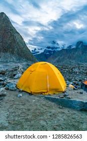 A lone tent on Baltoro Glacier Karakoram Mountain Range, Pakistan. Route to K2 base camp.