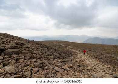 Lone Trail Runner Descending Scafell Pike, Lake District, England, UK