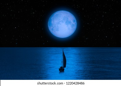 "Lone yacht with super Blue Moon ""Elements of this image furnished by NASA """