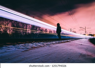 Loneliness man looking at his life at night long exposure train passing by
