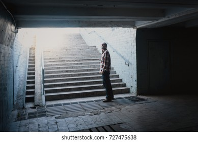 Loneliness man standing back in subway underground crossing