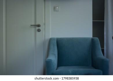 lonely armchair in the room next to the door