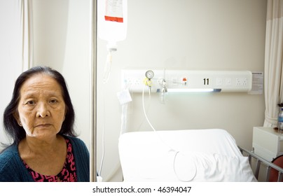 lonely asian old woman get infusion during inpatient treatment at the hospital