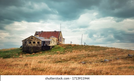 Lonely Barn Sitting on a Hill during Stormy Weather