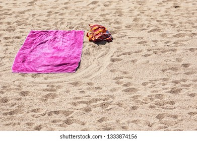 Lonely beach towel on the plage. Holiday conception.