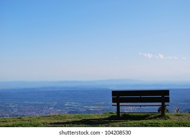 Lonely bench with breathtaking panoramic view on Po valley, Piedmont, Italy