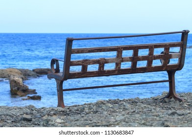 Lonely bench near the sea in Antalya, Phaselis.