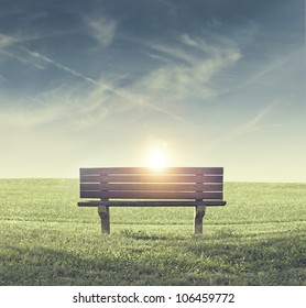 Lonely Bench in a Park During Sunset
