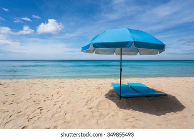 Lonely blue umbrella on Surin beach in Phuket