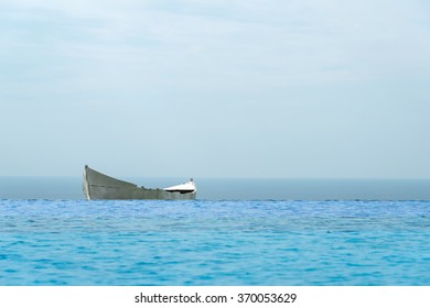lonely boat against the blue sea - selective focus, copy space