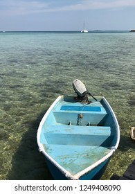 A lonely boat in the clear underwater beach in Karimunjawa island, Central Java, Indonesia