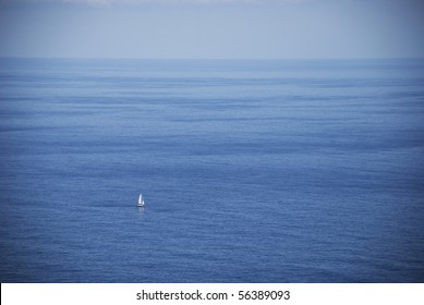 Lonely boat in endless ocean