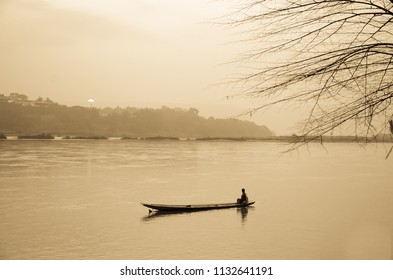 lonely boat and lonely fisherman