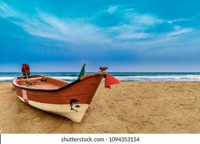 Lonely boat at mahabalipuram beach, India
