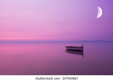 Lonely boat in the moonlight