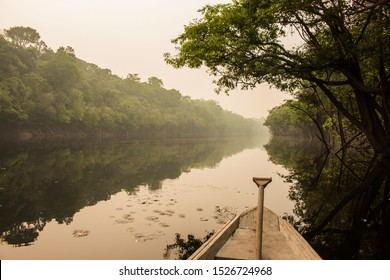 Lonely boat in the mysticism of the Amazon rainforest