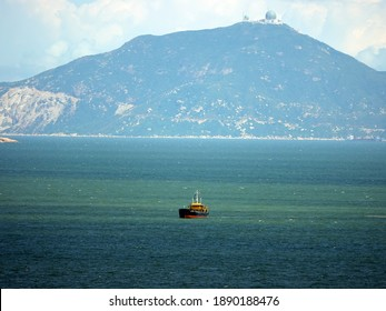 a lonely boat sailing in the sea