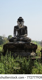 Lonely Buddha in ruined temple in Myanmar